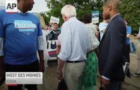 Bernie Sanders walks in Iowa Fourth of July parade