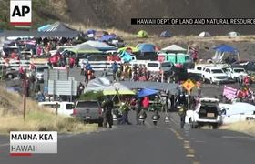 Hawaii telescope protesters block mountain road