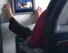 #VIRAL: Passanger swipping in flight entertainment screen with feet