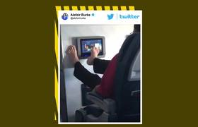 #VIDEO: Revolting passenger uses bare feet to browse airplane movies