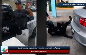 Policía quería arrestar a conductor y termina en el suelo en Puebla