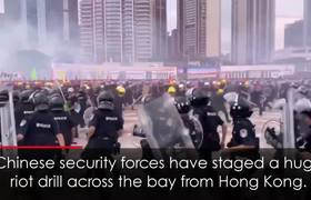 Chinese Riot Police Stage Mock Street Battle Near Hong Kong