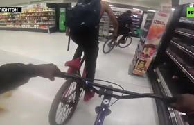Teens wrestle elderly lady, punch man as gang tears through UK supermarket riding bikes