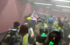Tear gas used amid chaos in Hong Kong as police clash with protesters at train station