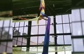 Girl Loses Balance on Aerial Silk Rope and Falls Down