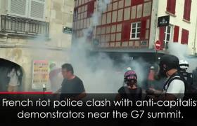French Riot Police Clash with Protesters at G7 Summit