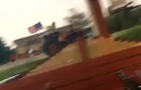 Police Pursue Patriotic Tractor