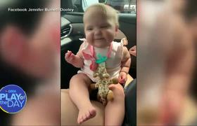 Baby dances with a french fry in hand