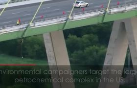 Greenpeace Campaigners Hang From Texas Bridge in Fossil Fuel Protest