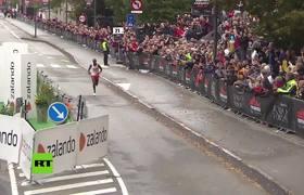 Runner breaks half marathon world record