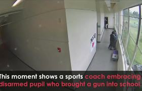#CCTV: Coach Disarms and Embraces Suicidal Student With a Gun