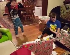 Kids Scream in Excitement After Unwrapping Their Christmas Presents