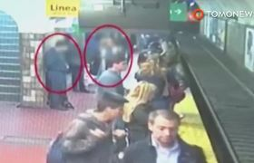 #CCTV: Woman falls on train tracks, rescued by platform passengers