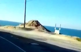 capture the moment when the car falls to a cliff
