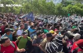 Topan migrantes con 'muro' de Guardia
