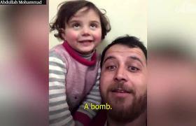 #OMG: Padre en Siria enseña a su hija a reir cuando cae una bomba