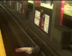 CCTV Video Man falls to the train tracks in Boston