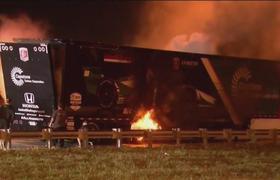Flames devour truck carrying Grand Prix race car