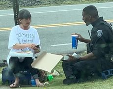 #VIRAL: Cop shares food with homeless woman in North Carolina