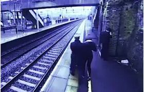 #VIDEO: Rescue a man within seconds of jumping onto the train tracks