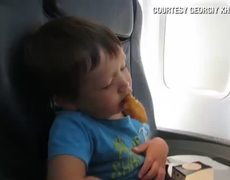 Cute baby falls asleep eating chicken