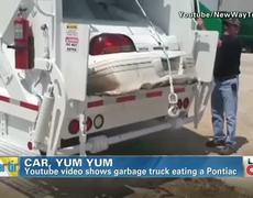 Garbage truck eat an entire car