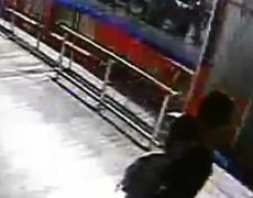 CCTV Video Thief hit by bus after robbing woman in Colombia