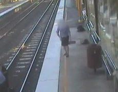 CCTV Video Trainee nurse saves man from train track in Australia