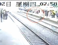 CCTV Video Man faints falls on tracks in China