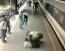 CCTV Dramatic Video Police Saves Suicidal Man From Jumping In Front Of Train In Medillin Colombia