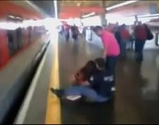 Dramatic Footage Womans Near Miss With Train