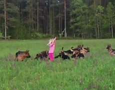 Cute girl plays with 14 dogs