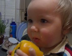 Toddler eats yellow pepper