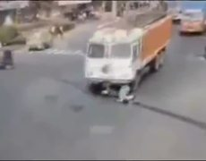 CCTV Video Miraculous escape of woman hit by truck in India