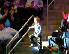 Funny Little boy dancing at the Rascal Flatts