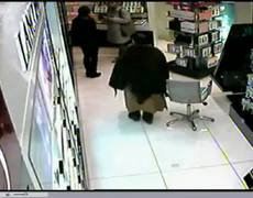 Caught On CCTV Old Woman Steals Shoplifts Perfume