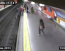 CCTV Woman falls into train tracks rescued by police