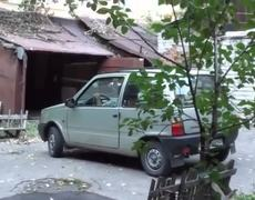 Crazy Woman trying to park her car in garage Hilarious
