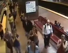 Transit Worker Saves Girl From Train Tracks