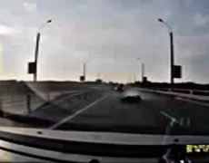 VIRAL VIDEO Motorcyclist crashes flips and sticks a perfect landing on a cars roof