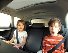 Funny kids singing somebody that I used to know in the car