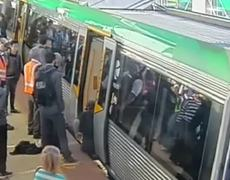 Original Video People power frees man trapped by Perth train