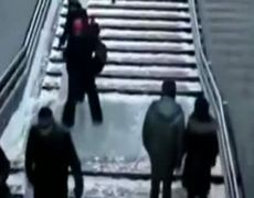 People fall on icy stairs