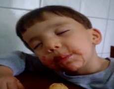 Sleeping Kid Eats Ice Cream
