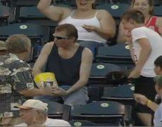 Fan Catches Baseball Using Popcorn Bucket