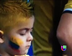 Colombian child reacts to seeing his face painted World Brazil 2014