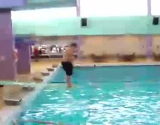 Fat guy fails to dive in pool