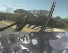Raw Video: One Killed in Car-Bus Collision