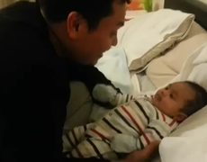 Dance battle between baby and his father