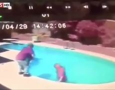 Caught on Video Man throws a baby in a pool